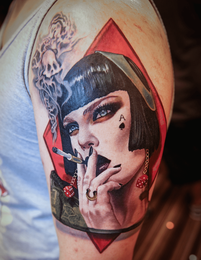 Gorgeous designed and colored shoulder tattoo of smoking woman with funny smoke