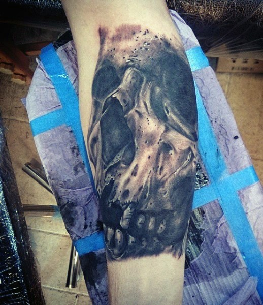 Gorgeous designed and detailed black and white old skull tattoo on arm