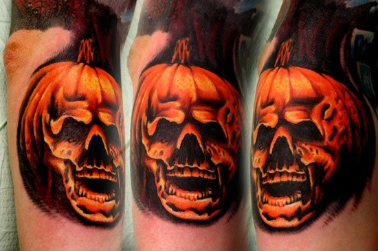 Gorgeous designed and painted colored skull shaped pumpkin tattoo on arm