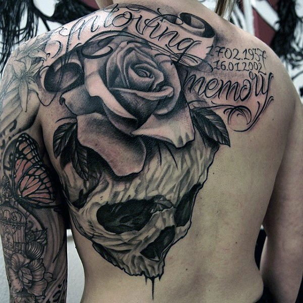 Gorgeous designed and painted massive memorial flower with lettering and skull tattoo on whole back