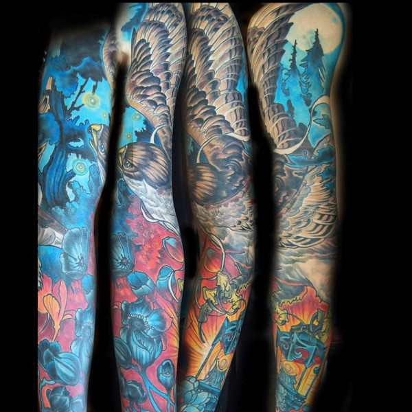 Gorgeous designed massive colorful flying eagle in night fores with flowers tattoo on sleeve