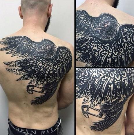 Gorgeous designed massive tribal crow tattoo on upper back