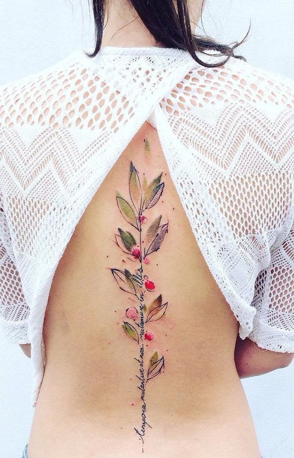 Gorgeous designed very detailed colorful plant tattoo on back with lettering