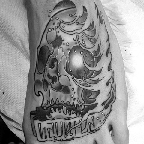 Gorgeous fantasy skull with lettering tattoo on foot