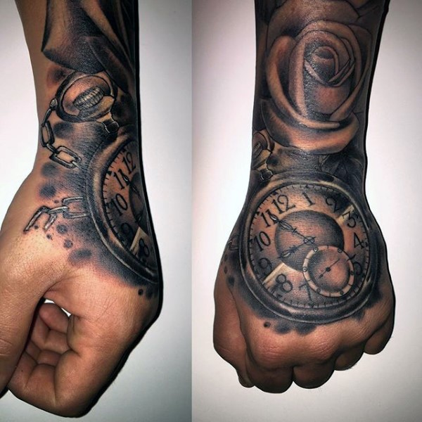 Gorgeous looking black and white antic clock with flower  tattoo on hand