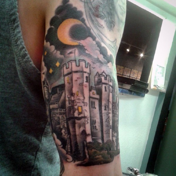 Gorgeous multicolored fantasy castle with moon tattoo on half sleeve area