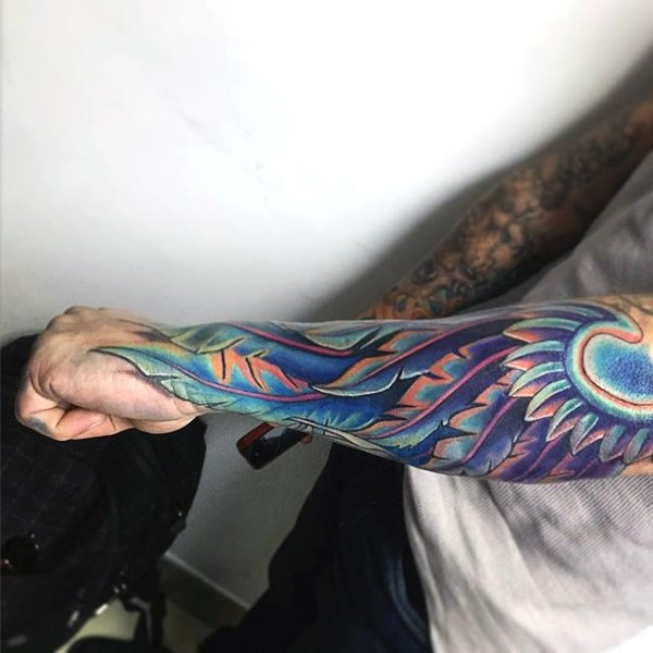 Gorgeous multicolored very detailed wing tattoo on sleeve