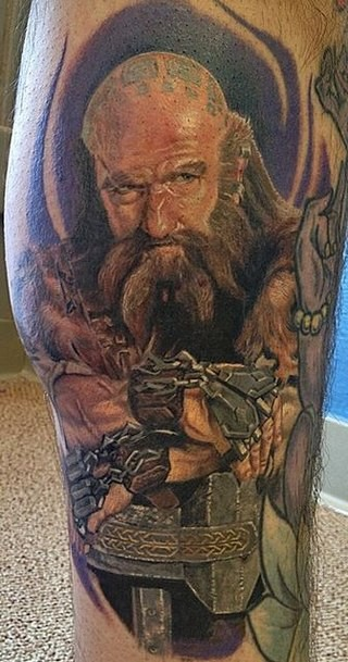 Gorgeous natural looking colored famous movie dwarf hero tattoo on leg