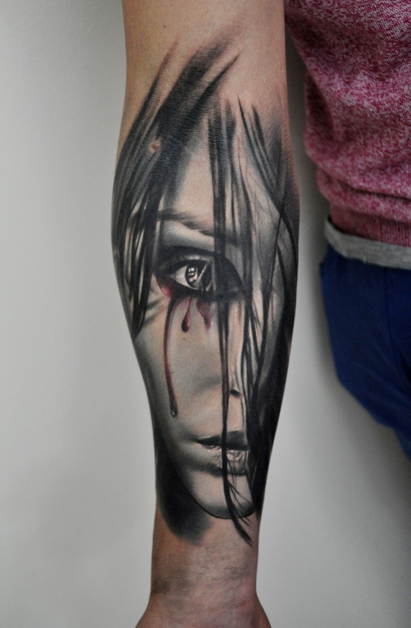 Gorgeous painted and colored forearm tattoo of woman face