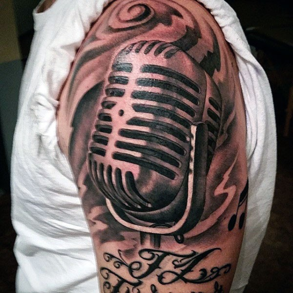 Gorgeous painted black and white microphone with lettering arm tattoo