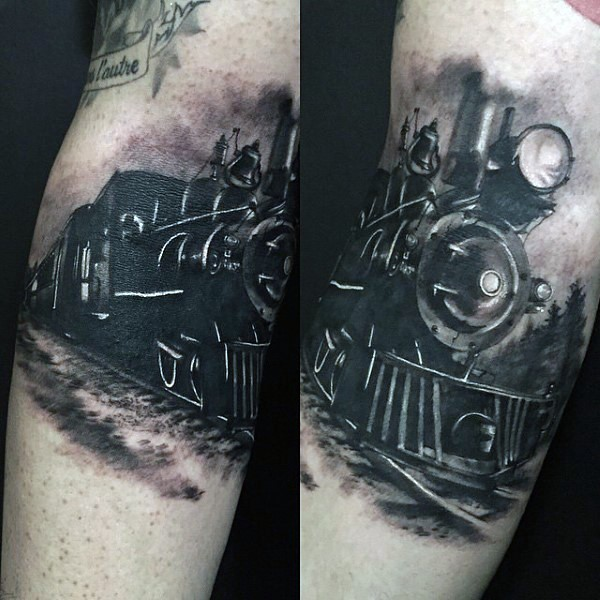 Gorgeous painted black and white train tattoo on leg