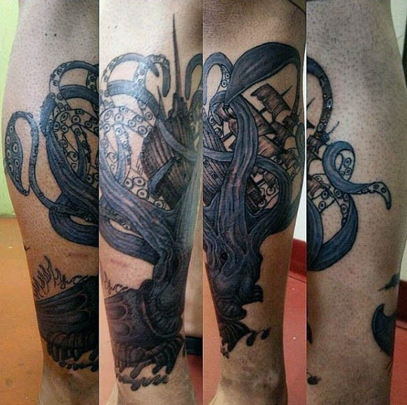 Gorgeous painted blue colored squid and ship tattoo on leg