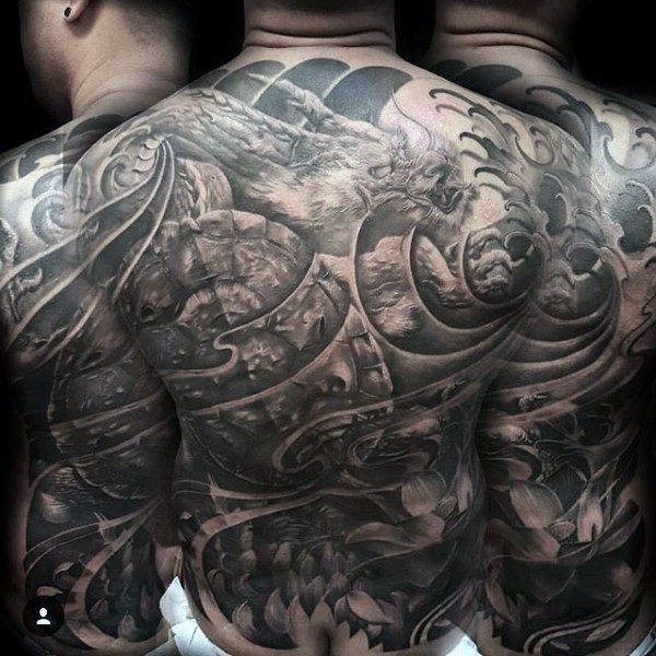 Gorgeous painted massive black ink dragon with flowers tattoo on whole back