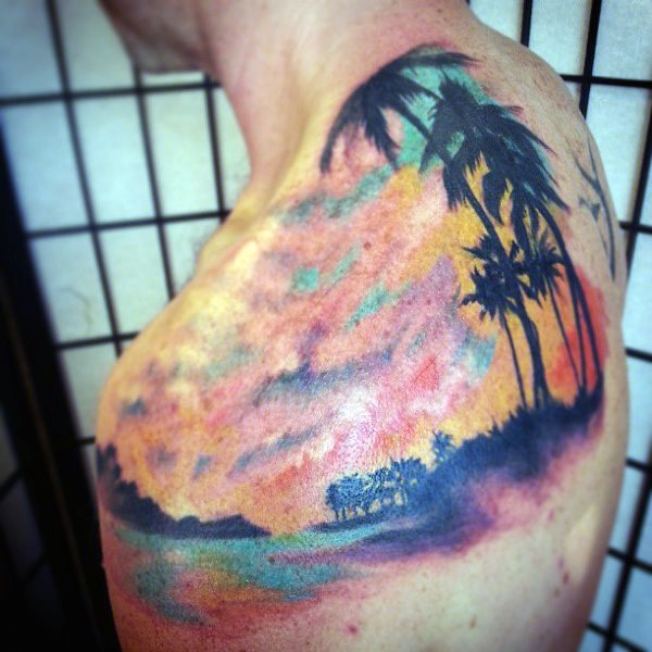 Gorgeous painted multicolored beach with palm trees tattoo on shoulder