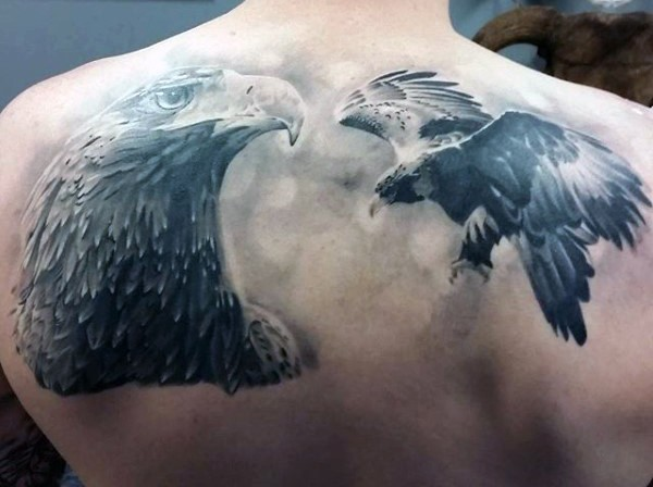 Gorgeous painted very detailed black and white eagle tattoo on upper back