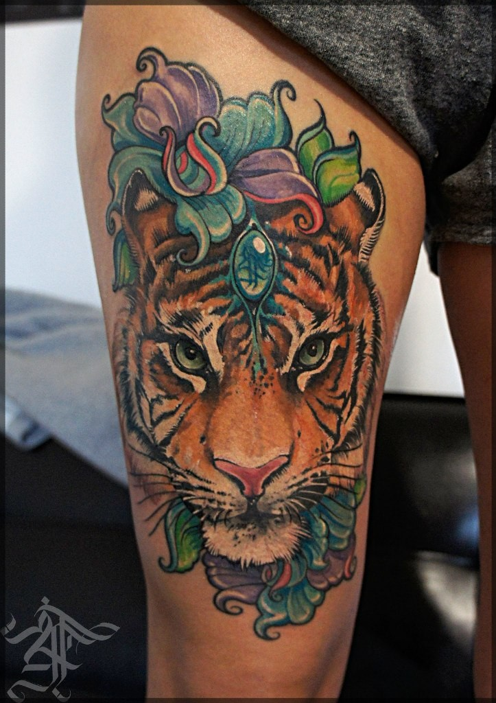 Gorgeous very beautiful colored natural looking tiger face tattoo on thigh stylized with flowers