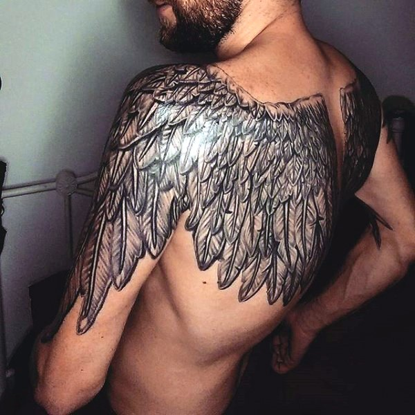 Gorgeous very detailed black and white wings tattoo on upper back and shoulders