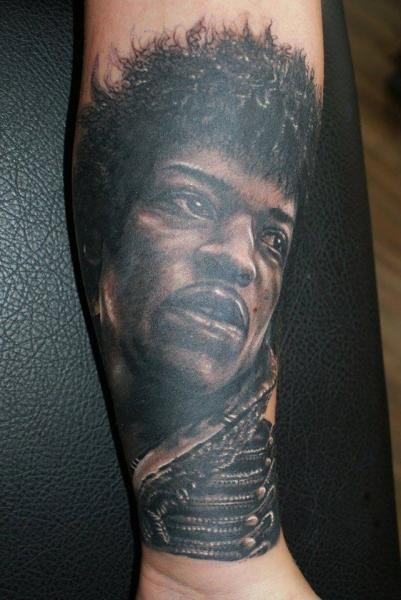Gorgeous very detailed black and white forearm tattoo of famous singer