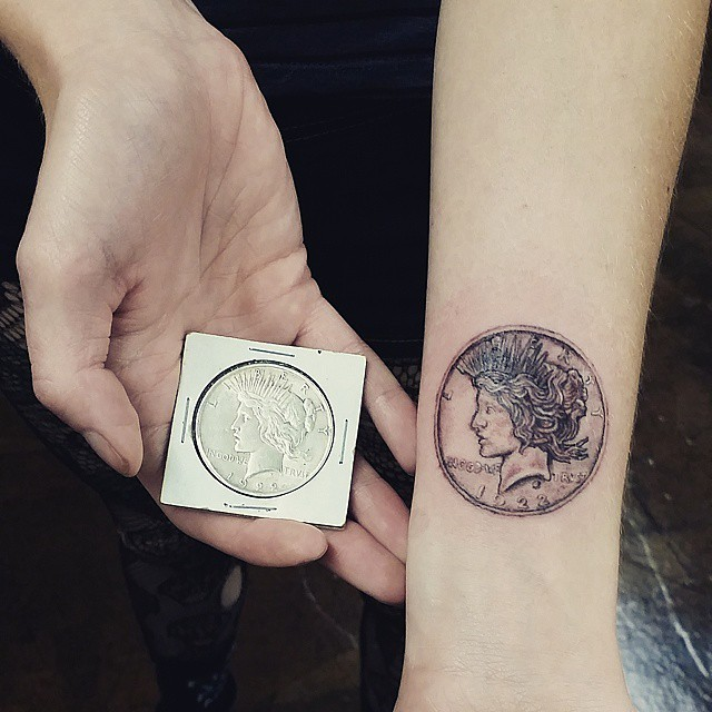 Gorgeous very detailed little wrist tattoo of cool coin