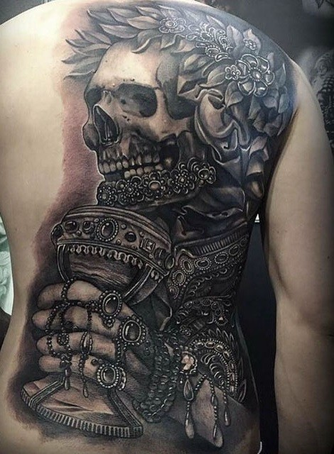 Gorgeous very detailed whole back tattoo of ancient skeleton with jewelries