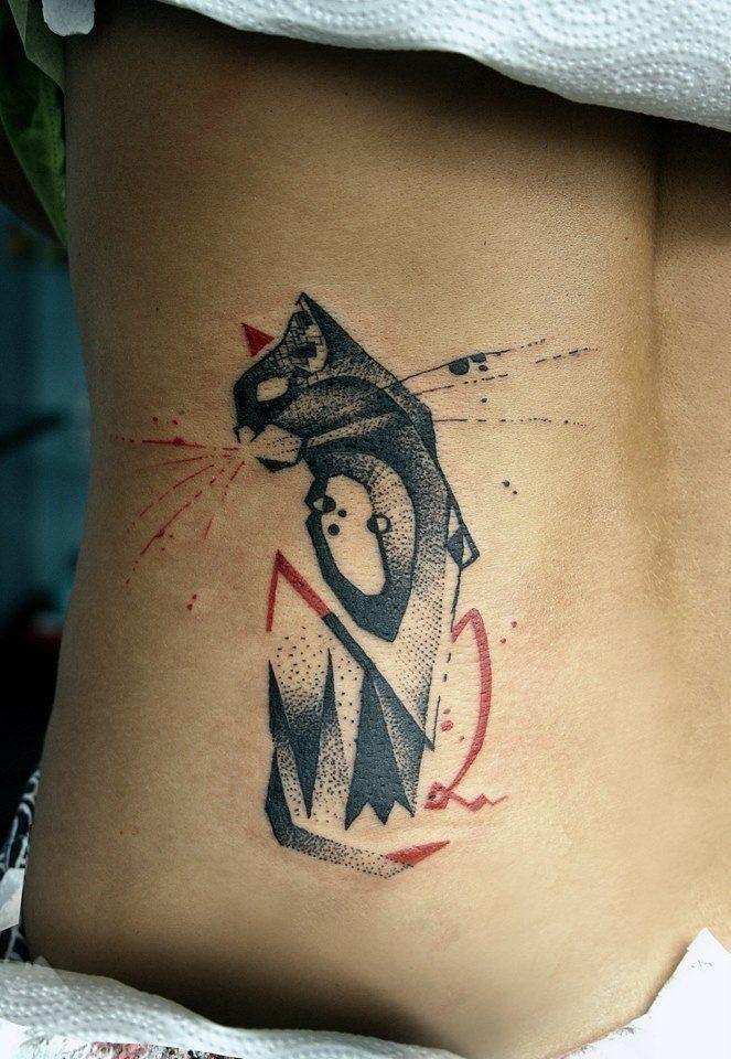 Graffiti dot style back tattoo of cat statue