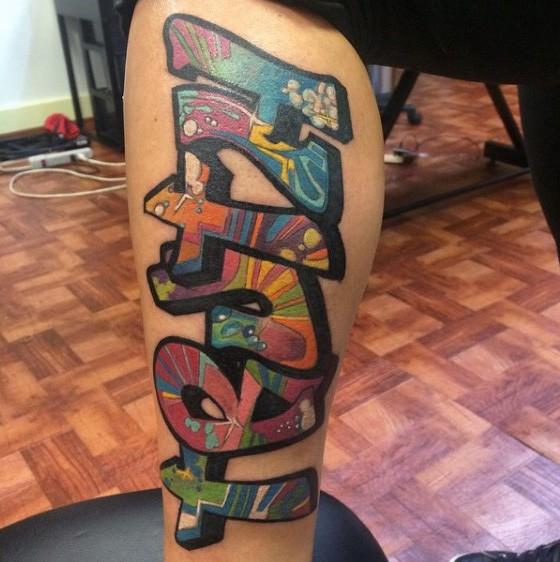 Graffiti style colored leg tattoo of funny lettering