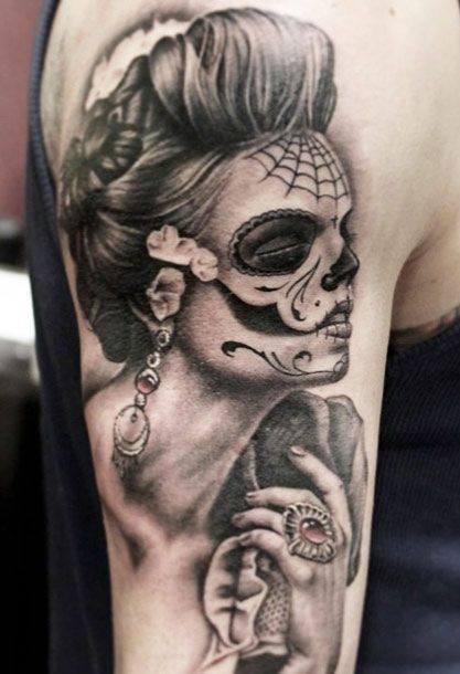 Gray ink day of the dead girl with ring tatoo