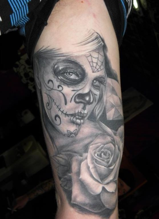 Gray ink day of the dead tattoo on arm