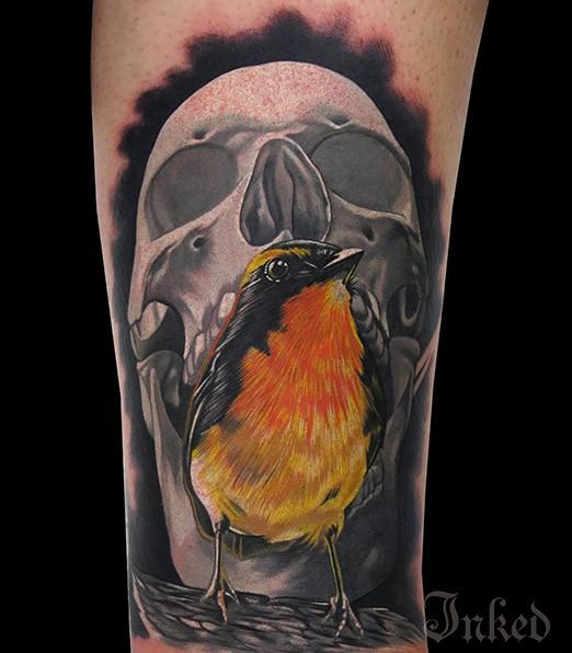 Gray skull with yellow bird tattoo