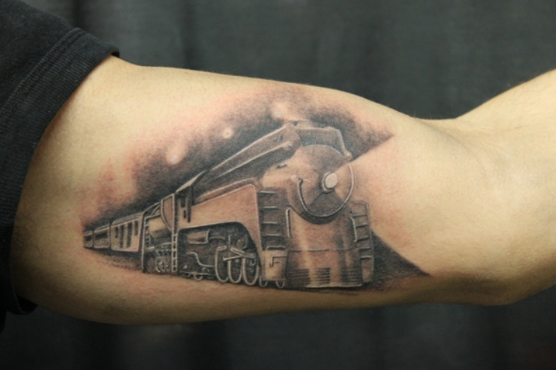 Gray washed style accurate painted fantasy train tattoo