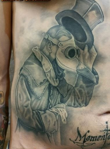 Gray washed style amazing looking belly tattoo of plague doctor with lettering