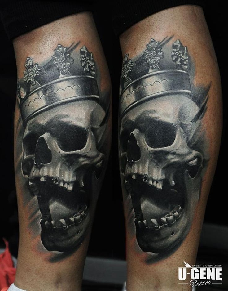 Gray washed style black and white leg tattoo of human skull with crown