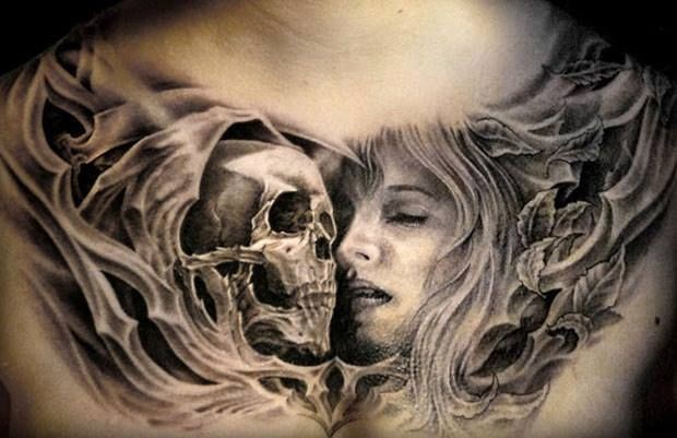 Gray washed style black ink chest tattoo of woman face and human skull