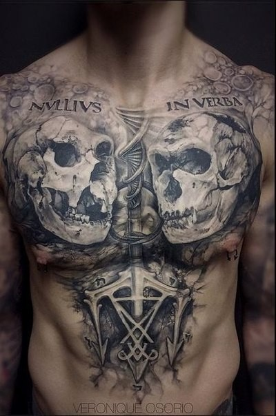 Gray washed style black ink chest tattoo of monkey skulls with lettering and DNA
