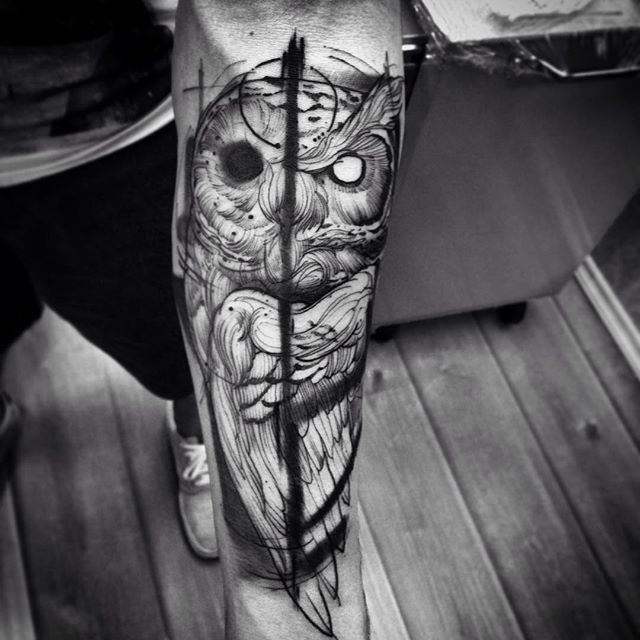 Gray washed style black ink forearm tattoo of mystical owl