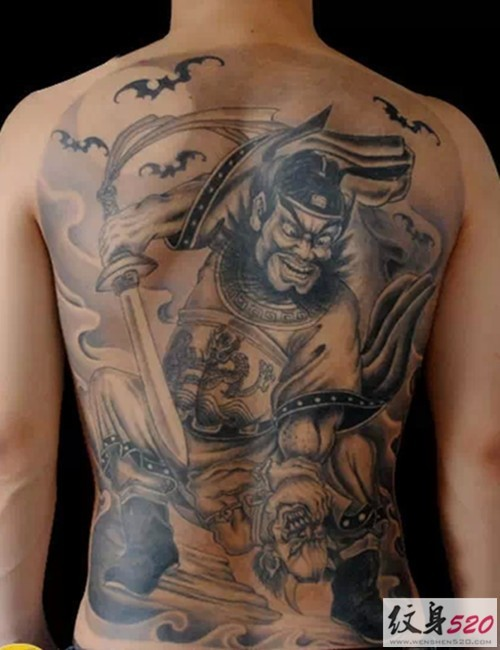 Gray washed style colored whole back tattoo of demonic warrior and bats