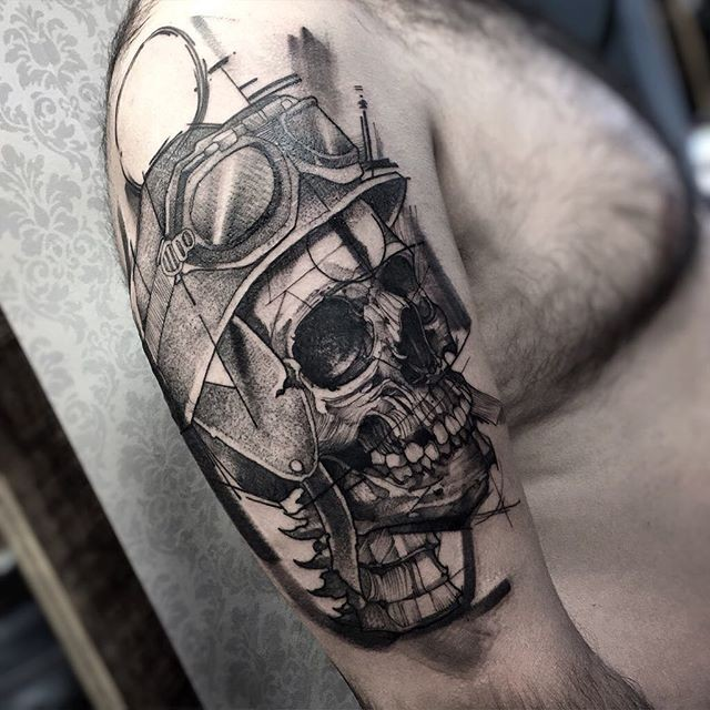 Gray washed style cool looking shoulder tattoo of bikers skull