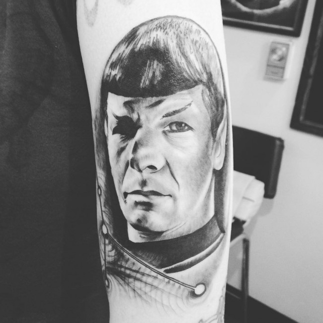 Gray washed style cool looking shoulder tattoo of Spock portrait