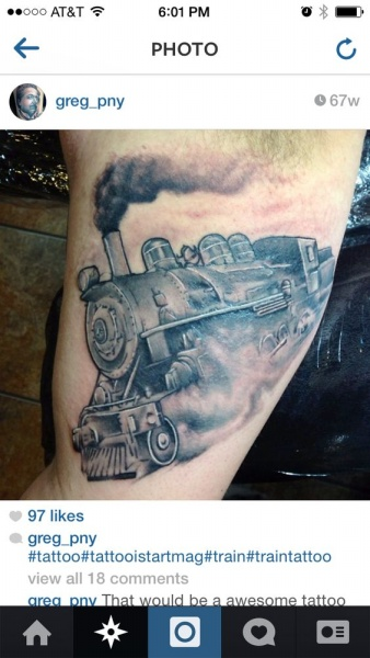 Gray washed style detailed biceps tattoo of steam train