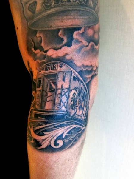 Gray washed style detailed half sleeve tattoo of city train and clouds