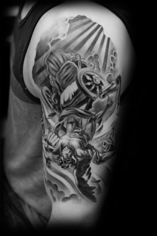 Gray washed style detailed shoulder tattoo of Icarus with with sun
