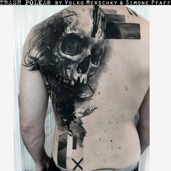 Gray washed style large detailed back tattoo of human skull with geometrical ornaments