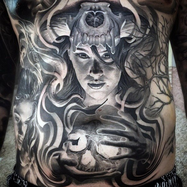 Gray washed style large mystical witch tattoo on belly with human skull