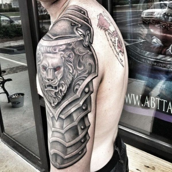 Gray washed style medieval shoulder armor tattoo stylized with lion