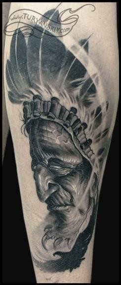 Gray washed style realistic looking forearm tattoo of Indian portrait