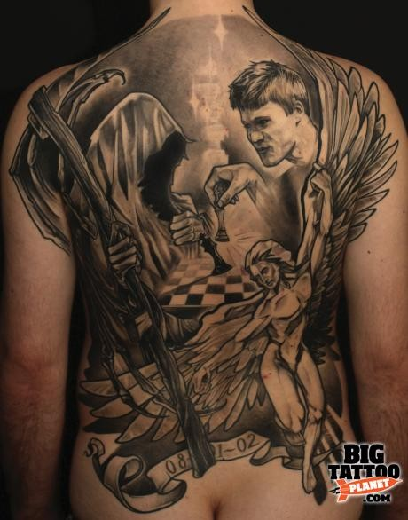 Gray washed style religious themed back tattoo