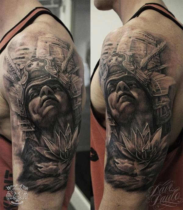 Gray washed style shoulder tattoo of ancient Aztec warrior with flower