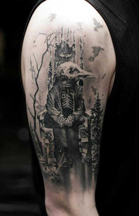 Gray washed style shoulder tattoo of creepy looking bird skeleton king with forest