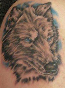 Gray wolf with blue eyes tattoo