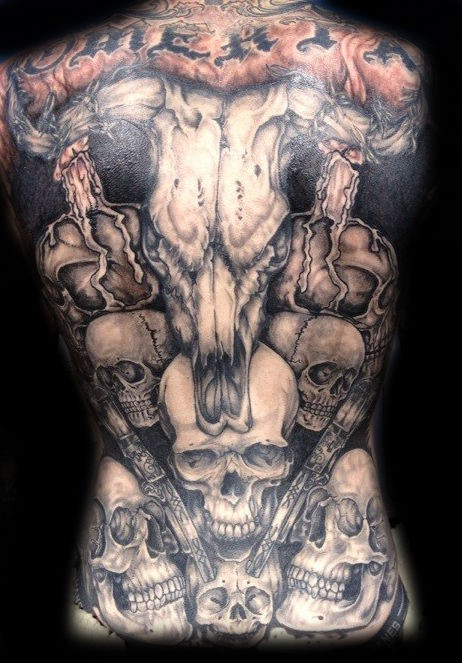 Great animal skull with guns and skulls tattoo on whole back